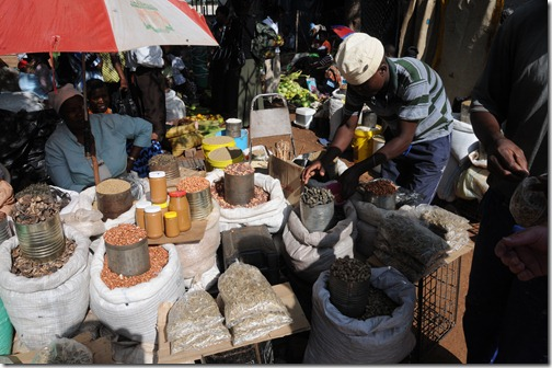 Zimbabwean Market near Victoria Falls: Note the cans full of caterpillars and other bugs