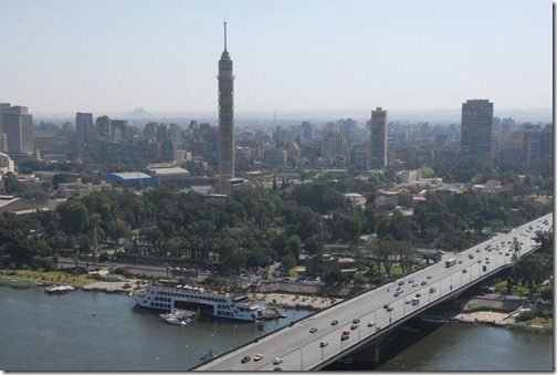 View of the Nile from the Ramses Hilton, Egypt - Note the Pyramids on the far background