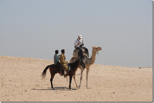 My camel guide and his assistant getting a shake down