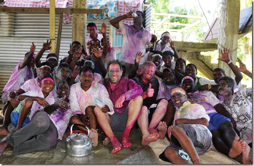 Covered in dye, celebrating Holi with our new friends, the traveling Hindu Holi band!
