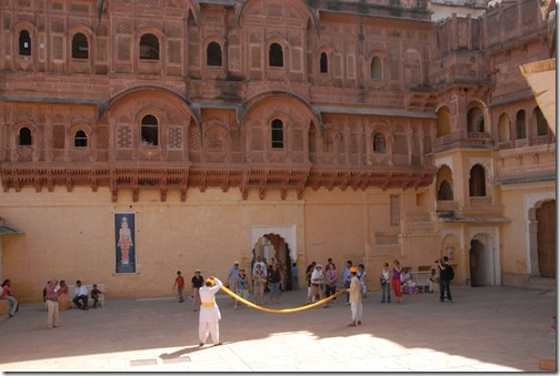 Museum guides demonstrating how to put a turban on at Mehrangarh Fort in Jodphur, Rajasthan, India