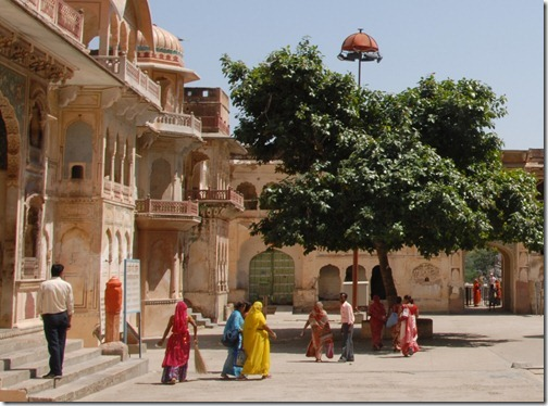 "Brightly colored pilgrims at Galtaji, near Jaipur, Rajasthan, India.  This place is also known as the ""Monkey Temple"" or Galwar Bagh."