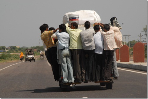 An overloaded auto rickshaw speeding down the motorway in Uttar Pradesh, India