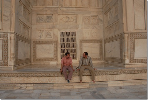 Relaxing and contemplating life on the warm white marble of the Taj Mahal in Agra, India