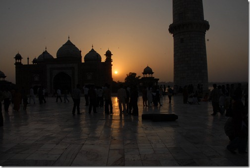 The Taj Mahal Mausoleum and Mosque at sunset in Agra, India