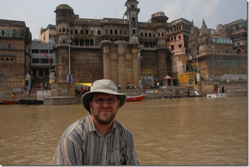 Taking a boat by the ghats along the Ganges River in Varanasi, India