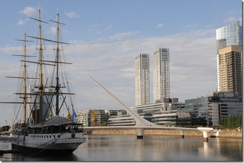 The museum ship 'President Sarmiento' docked in the Puerto Madero district with the Puente de la Mujera (Woman's Bridge) in the background - Buenos Aires, Argentina.