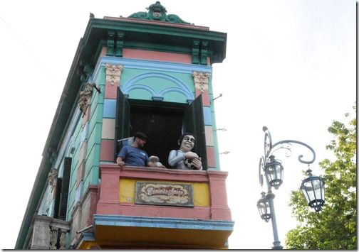 Standing on the balcony above the Caminito in La Boca neighborhood, Buenos Aires, Argentina. I'm told this is the picture to take when in Buenos Aires.