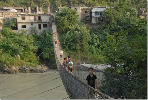 Suspension footbridge across a Himalayan river near Baireni, Nepal