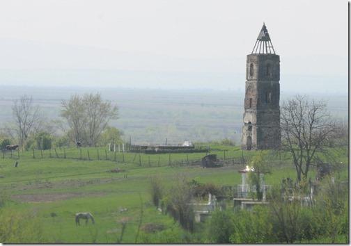 Tower of the old destroyed Cacova Church near Grădinari, Romania