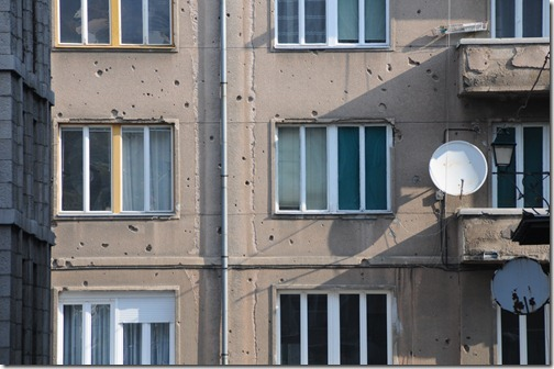 Artillery shell damage on the walls of buildings in Sarajevo, Bosnia-Herzegovina