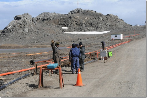 Workers putting in new infrastructure between the airport and the Russian and Chilean settlements on King George Island, Antarctica.