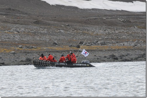 "Researchers from the Korean Base, ""King Sejong Station"" arriving in a Zodiac to the Russian/Chilean stations in Antarctica"