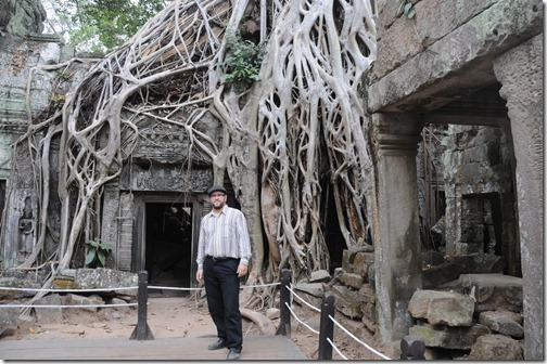 Self-portrait near the famous strangler-vine covered doorway in the Ta Prohm (Tomb Raider) Temple, Angkor region, Cambodia