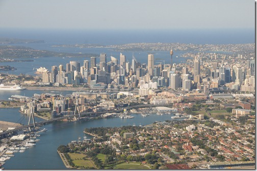 Aerial view of Sydney, Australia showing the Anzac Bridge, the C.B.D., and the Sydney Tower