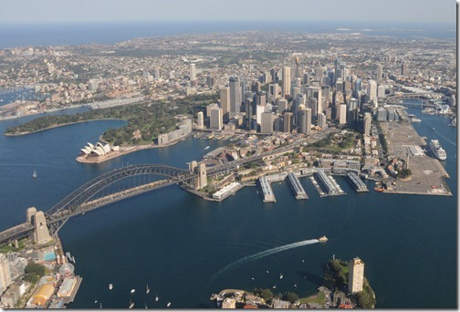 Aerial view of Sydney Harbour in Sydney, Australia showing the Sydney Harbour Bridge, the Opera House, and the Central Business District