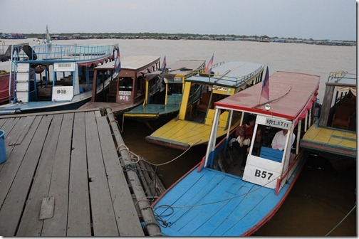 Longboats parked at the bar/restaurant in the Floating Village of Chong Kneas on Tonlé Sap lake, Cambodia.