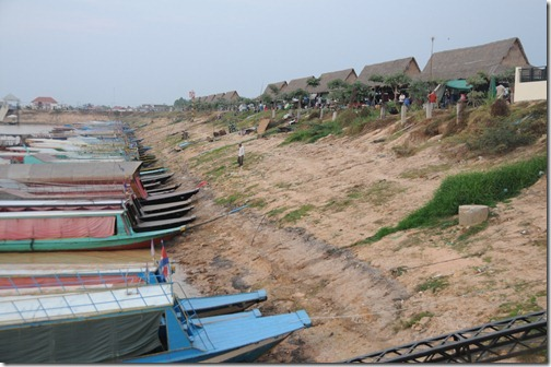 Boats tied to the Marina on Tonlé Sap lake. Note the huge drop from the current shore of the lake in dry season to where it ends up in monsoon season.