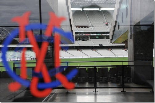 View of the interior of the Melbourne Cricket Ground (MCG) through a plaza door in Melbourne, Victoria, Australia