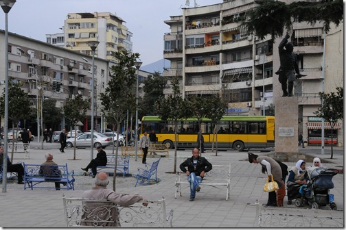 Albanians relaxing in a square in Tirana, Albania