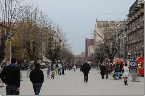 Pedestrians on Mother Teresea Boulevard in Pristina, Kosovo