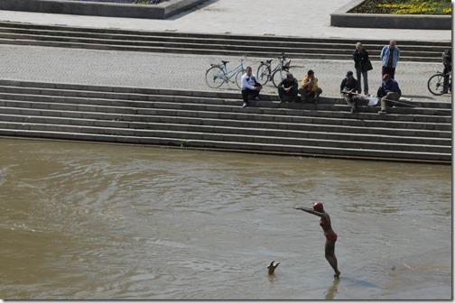 Whimsical statues of women diving into the Vardur River in Skopje, FYRO Macedonia