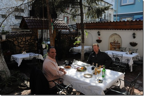 Joel and Paul dining in the patio of the Restaurant Manastirska Magernitza (Ресторант Манастирска Магерница) in Sofia, Bulgaria