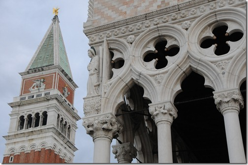 Detail of the Doge's Palace with the Campanile di San Marco (St. Mark's bell tower) in the background
