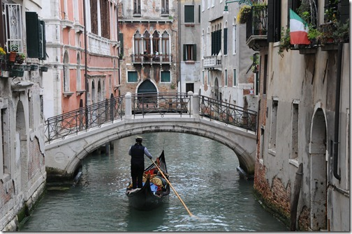 Gondola navigating the canals of Venice, Italy