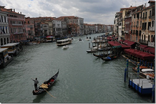 View of a Gondola in the Grand Canal from the Rialto Bridge in Venice, Italy
