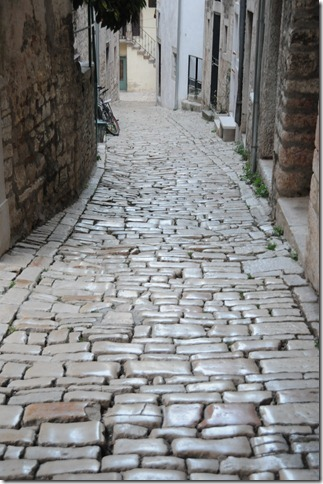 Smooth rounded cobblestones on the narrow streets of Rovinj, Istria, Croatia