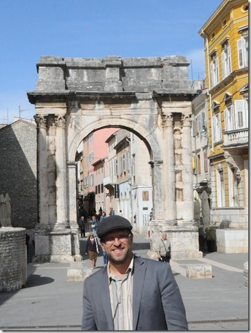 Self-portrait at the Arch of the Sergii, a Roman triumphal arch in Pula, Istria, Croatia