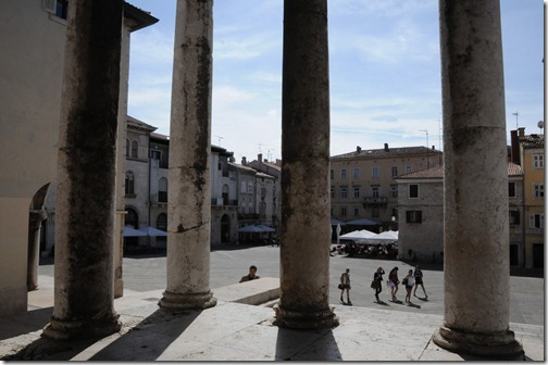 View through the columns Temple of Augustus in Pula, a Roman religious temple, one of the few remaining in the world - In Pula, Istria, Croatia