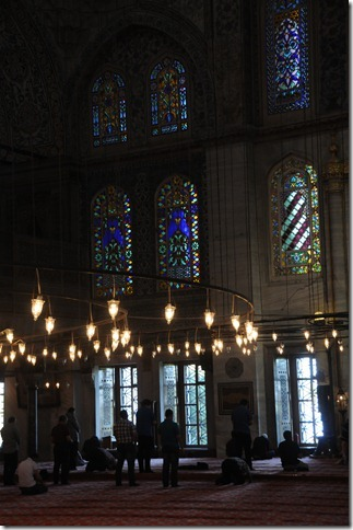 Prayers inside the Sultan Ahmed (Blue) Mosque (Sultanahmet Camii) in Istanbul, Turkey