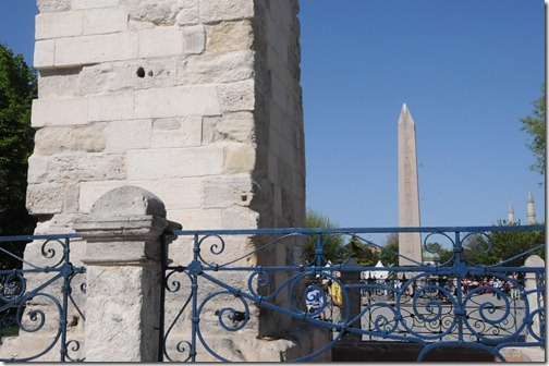 The Walled Obelisk in the forefround and the Obelisk of Theodosius in the background in the location of the ancient Hippodrome of Constantinople (present day Sultanahmet Mehdani) in Istanbul, Turkey
