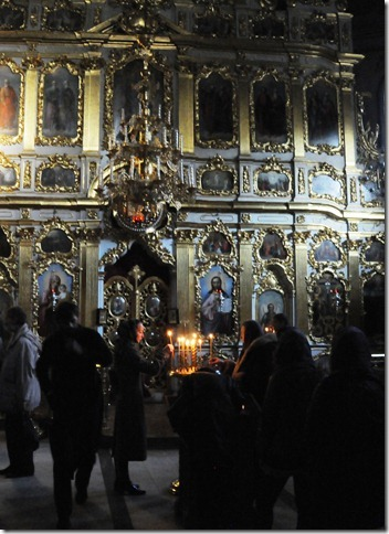 Pilgrims lighting candles inside the Kiev Pechersk Lavra (Києво-Печерська лавра), or the Monastery of the Caves, in Kiev, Ukraine