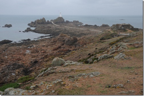 La Corbière lighthouse at low tide on the southwest corner of Jersey, Channel Islands (Jèrri, Îles d'la Manche)