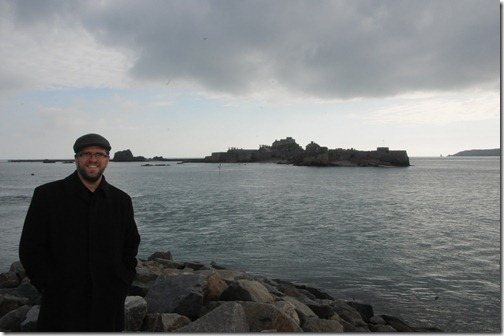 Self-portrait with Elizabeth Castle at high tide shown in Jersey, Channel Islands