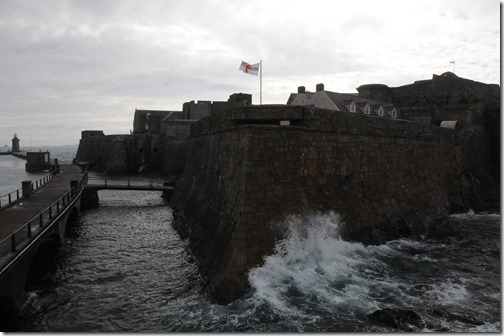 Waves breaking against Castle Cornet in St. Peter Port, Guernsey, Channel Islands (St Pierre Port, Guernesey, Îles d'la Manche)