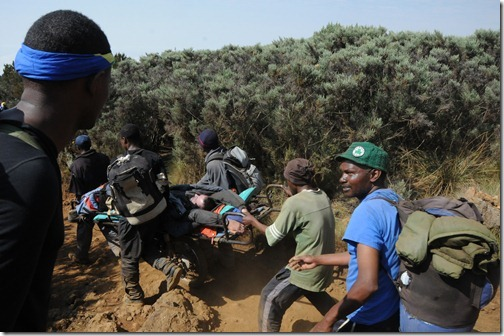The 'Kilimanjaro Express' taking a hypoxia patient down on a stretcher on Mount Kilimanjaro