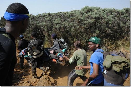 The 'Kilimanjaro Express' taking a hypoxia patient down on a stretcher on Mount Kilimanjaro