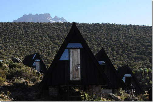 A-frame huts at Horombo Camp with Mawenzi Peak in the background - Mount Kilimanjaro, Tanzania