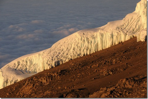 The Southern Icefields at dawn, mottled from constant melting on the slopes of Kibo Peak, Mount Kilimanjaro