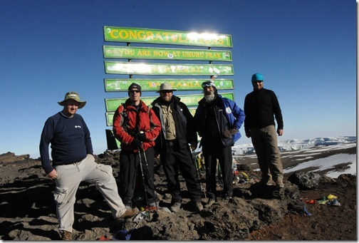 The Sharing the Point crew of (left to right) Joel Oleson, Eric Harlan, Michael Noel, Mark Miller, and Paul Swider at Uhuru Peak, Mount Kilimanjaro