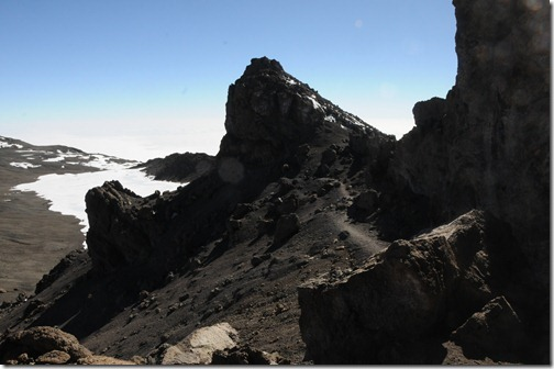 Descending on the trail around the rim of the Kibo crater on Mount Kilimanjaro