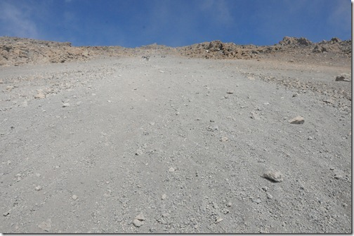 A view of the steepness of the scree field from Gilman's Point to Kibo Hut on the slopes of the Marangu Route down Kibo Peak, Mount Kilimanjaro