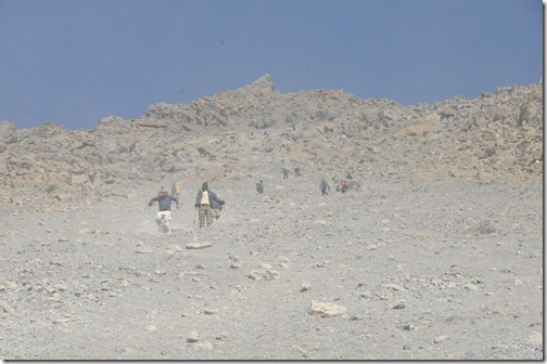 'Skiing' down the scree field from Gilman's Point to Kibo Hut on the slopes of the Marangu Route down Kibo Peak, Mount Kilimanjaro