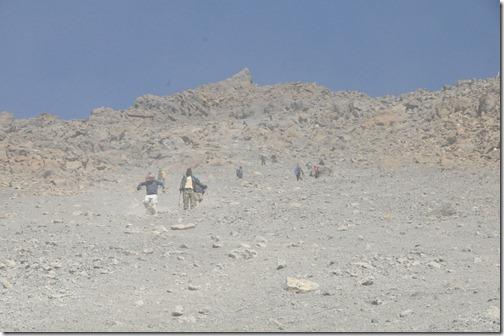 'Skiing' down the scree field from Gilman's Point to Kibo Hut on the slopes of the Marangu Route down Kibo Peak, Mount Kilimanjaro