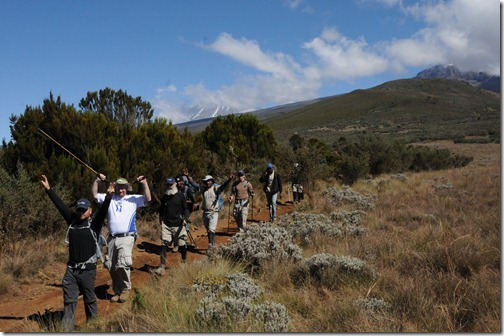 STP Africa team and guides triumphantly decending on the Day 6 hike down from Horombo Huts to Marangu Gate, Mt. Kilimanjaro, Tanzania