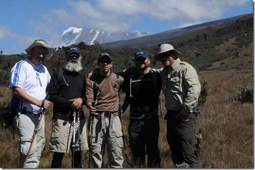 STP Africa team of (left to right) Joel Oleson, Mark Miller, Eric Harlan, Paul Swider, and Michael Noel with Kibo Peak in the background after a successful summit attempt in September, 2012